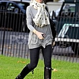Gwen Stefani bundled up in a scarf and hat.