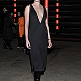 Anne Vyalitsyna's plunging black dress was juxtaposed via black knee-high Christian Louboutin boots at Sally Lapointe.