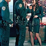 Leighton Meester and a cop filming Gossip Girl in NYC.