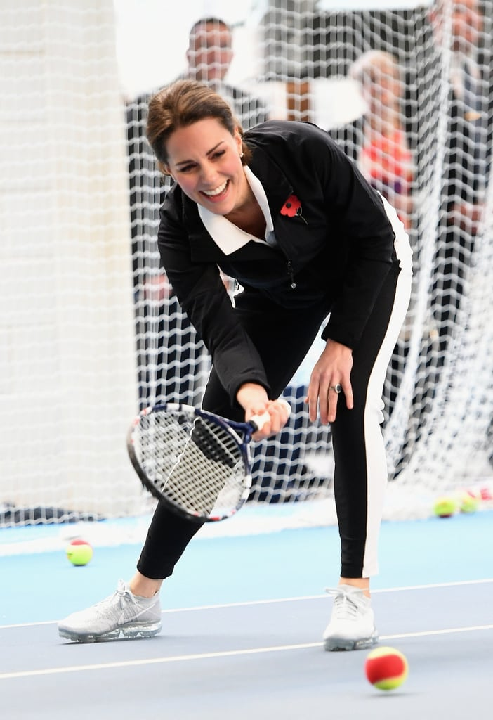 """The Duchess of Cambridge is a self-proclaimed tennis fan, and it certainly showed during her latest appearance in London. On Tuesday, the royal, who is currently pregnant with her third child, served up some serious fun as she visited the Lawn Tennis Association at the National Tennis Center. Sporting a fashionable black tracksuit and trainers, Kate couldn't contain her laughter as she tossed the ball around with some kids on the court. She even gave one boy a congratulatory high five after their one-on-one. Once again, she has proven that she's not too """"princessy"""" to play sports, and we love it.       Related:                                                                                                           19 Times the Duke and Duchess of Cambridge Showed Love During Sporting Events"""
