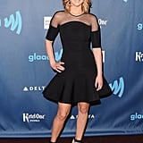 Jennifer Lawrence stepped out in a flirty David Koma LBD with a sheer inset at the neckline and a flared hemline. She finished with a pair of black patent, gold metallic ankle-strap heels by Nicholas Kirkwood and diamond and enamel jewels by David Webb.