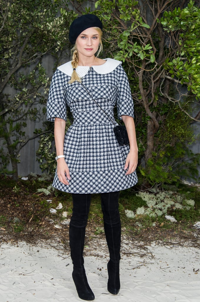 Diane Kruger always comes out to support Karl Lagerfeld, and today's Chanel Couture show was no different. The German actress wore a schoolgirl-looking dress and partnered it with a simple black shoulder bag, knee-high boots, and a black beret.