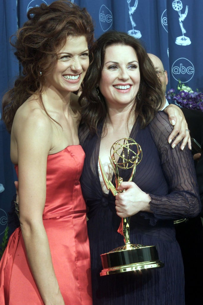Will and Grace costars Debra Messing and Megan Mullally shared a hug in 2000.