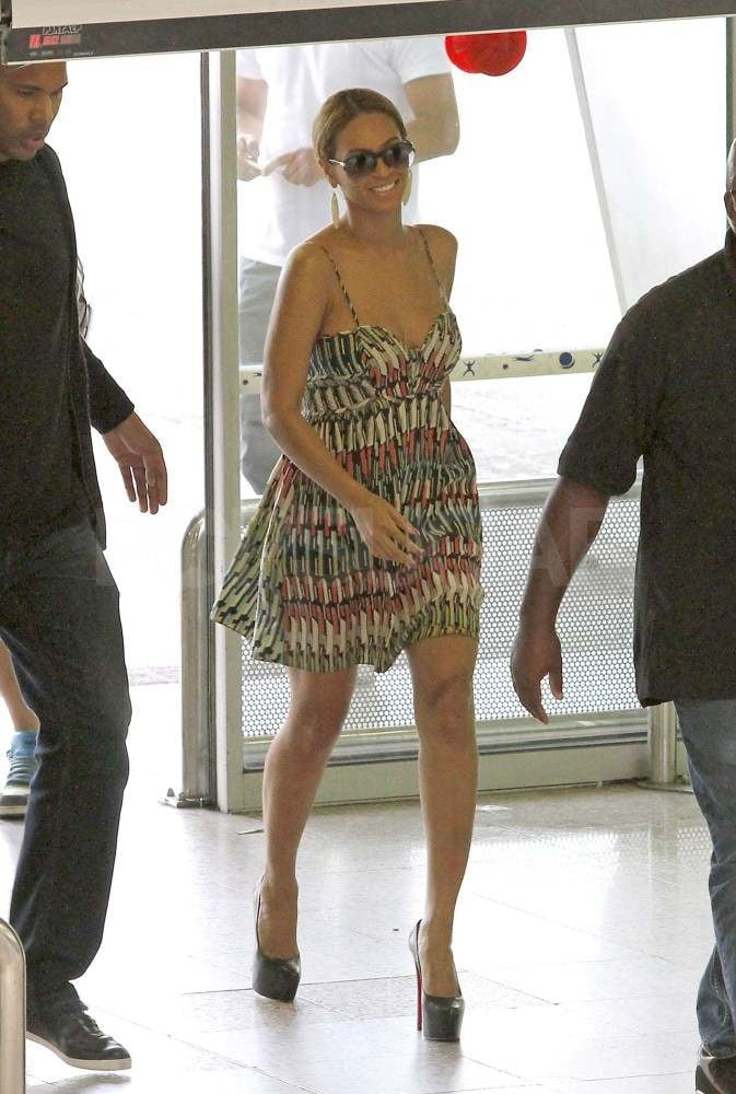 "Beyoncé Knowles was in a short printed Parker dress and sky-high Louboutin heels as she made her way into the airport in Nice today. She kept her cool with her bodyguards and her mom, Tina, by her side as she created a stir among fans — one woman even tripped attempting to snap a picture of the singer. It was a quick trip to the French city for Beyoncé, who landed in Nice on Sunday. Beyoncé's been making the rounds to promote her album 4 ahead of its release later this month, but first she'll perform some of her new hits at the Glastonbury music festival. The record's first single, ""Run the World (Girls),"" was out last month, and Beyoncé recently released ""Party,"" a collaboration with Kanye West and André 3000. Beyoncé is clearly on top of her game, and it shows with her spot in the PopSugar 100. You'll have to wait and see where she lands in the ranking when we release the list tomorrow, but the sexy star is definitely a top contender!"