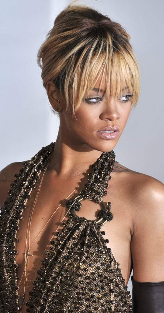 Rihanna wore a plunging neckline at the Brit Awards.