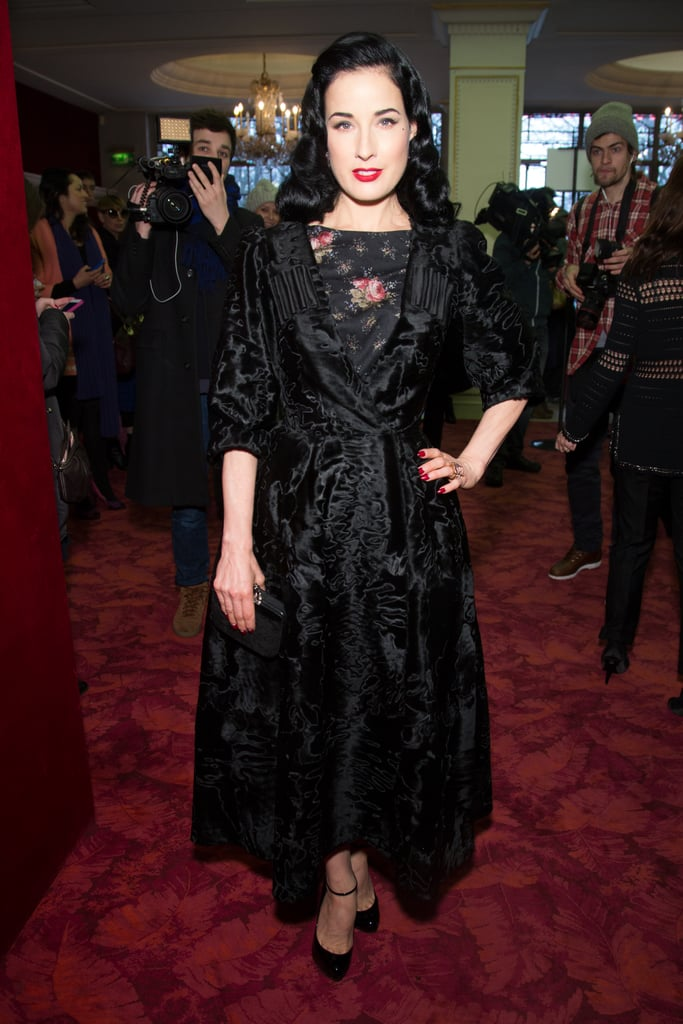 Dita Von Teese donned a plush velvet coat over a floral dress at the Ulyana Sergeenko show at Paris Couture Fashion Week.