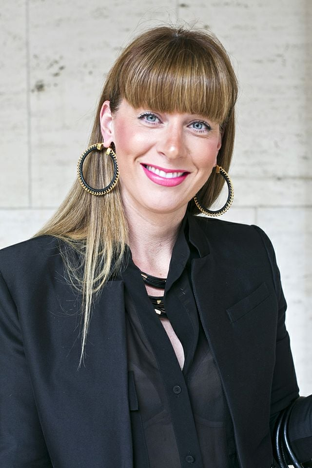 Full bangs are a Fashion Week staple, especially when paired with bold, neon-pink lips.  Photo by Caroline Voagen Nelson