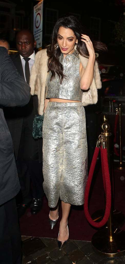 Amal teamed a pair of metallic Lanvin culottes with a matching vest, then wore a furry bolero up top.