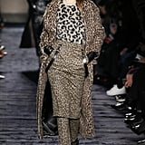 The model mixed and matched different color leopard prints on the Max Mara runway.