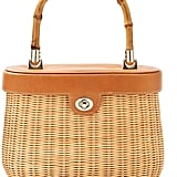 The bamboo handle on this J.Mclaughlin Ava wicker satchel ($266) gives it a vintage feel.