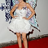 Alyssa Milano wore wings to celebrate in LA in 2006.