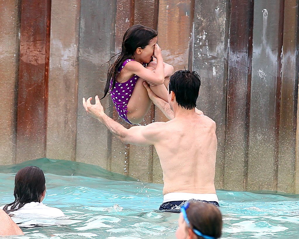Suri Cruise played in the water with Tom Cruise.