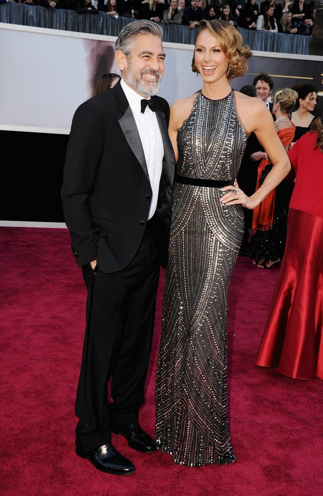 George Clooney and Stacy Keibler on the red carpet at the Oscars 2013.