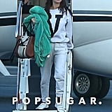 Selena Gomez Wearing Gray Sweatpants on a Plane