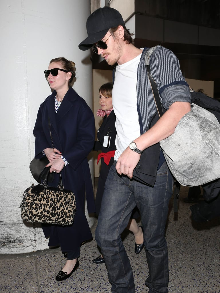 Kirsten Dunst and her boyfriend, Garrett Hedlund, landed at LAX yesterday after spending time in Paris for Fashion Week. While in Paris, Kirsten and Garrett sat front row at Saint Laurent on Monday, right next to Vogue Editor Anna Wintour. The couple's prime seats were fitting since Garrett is the ambassador for YSL's newest men's scent, La Nuit de L'Homme. With Fall Fashion Week wrapping up, Kirsten and Garrett are sure to get back to work. Her upcoming film Upside Down is out in select theaters March 15, and Garrett's YSL fragrance ad will come out in Spain, Italy, and Germany this month.