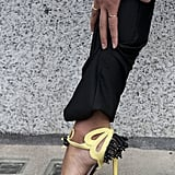 Black and yellow sandals provided flourish to a pair of black trousers.