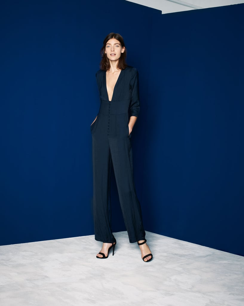 Shop the look:  Jumpsuit With Low Neckline ($80) Shiny High Heel Strappy Sandal ($100)