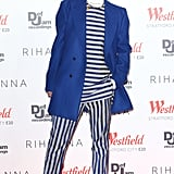 The singer took borrowed-from-the-boys to heart in a blue and gray striped top, matching trousers, both from Acne's men's Spring 2013 collection, and a statement cobalt men's coat from Raf Simons while lighting the Westfield Stratford City Christmas lights in London.