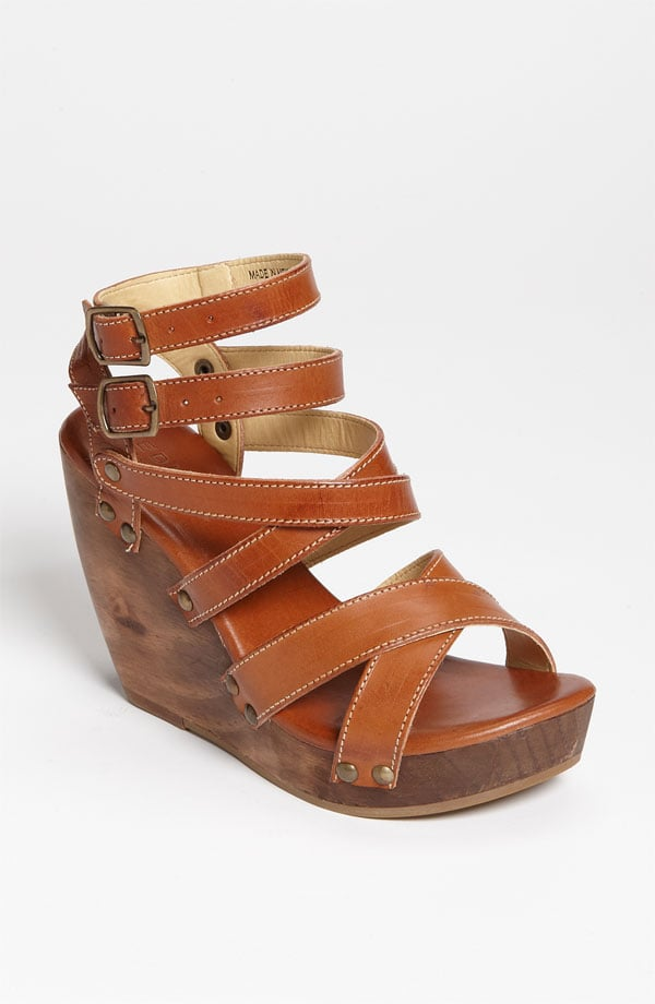 Wear these orange wrap-around heels with a pair of lacy white shorts.  Bed-Stu Julie Sandal ($125)