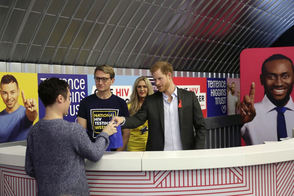 """Prince Harry is following in Princess Diana's footsteps! On Wednesday, the royal visited the Terrence Higgins Trust HIV Testing Centre in London to kick off this year's National HIV Testing Week, which runs from Nov. 18 to Nov. 25. The pop-up centre aims to provide a space where people can access information regarding HIV/AIDS and will provide full support and treatment to people who test positive. During his visit, Harry handed out HIV self-test kits to local residents and met with volunteer Andrew Bates, who was diagnosed with HIV in 2015. """"So the instructions are idiot-proof for people like myself?"""" Harry jokingly asked while learning about the HIV self-test kits, which provide results in just 15 minutes.         Related:                                                                                                           8 Ways William and Harry Are Keeping Princess Diana's Legacy Alive               Diana did so much to promote awareness and remove the stigmas of AIDS when she was alive, and as a result, the cause has also become close to Harry's heart. In addition to travelling to Africa to work with children affected with AIDS, Harry set up his charity Sentebale to support orphans and children affected by the epidemic, and he also challenged the HIV stigmas when he visited a local HIV clinic in London and got tested live on Facebook in 2016. If only there were more people like Harry out there."""