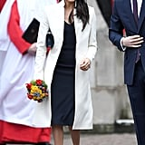Wearing a custom Stephen Jones beret, Manolo Blahnik pumps, and a cream coat by Amanda Wakeley for the Commonwealth Day service.