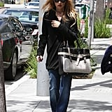 Rachel Zoe wore her signature wide-leg jeans with an awesome Reed Krakoff tote.
