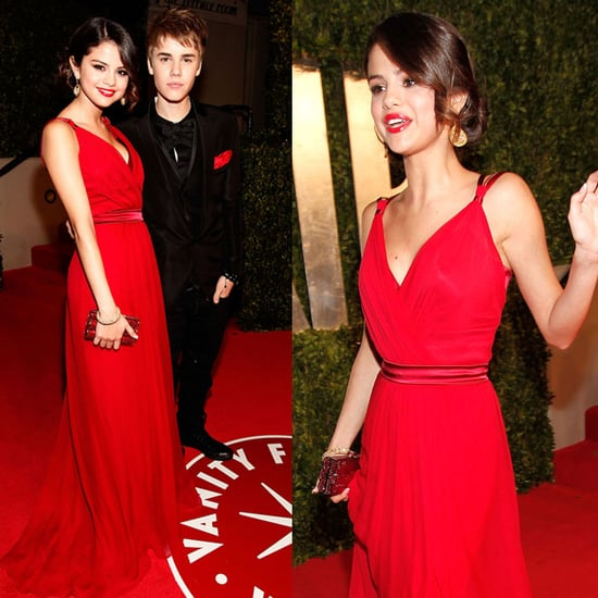 Selena Gomez in Dolce & Gabbana and Justin Bieber at Vanity Fair Oscars Party 2011