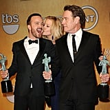 Breaking Bad costars Aaron Paul, Anna Gunn, and Bryan Cranston got kissy after winning their SAG Award.