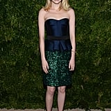 At the ninth annual CFDA/Vogue Fashion Fund party in NYC, Emma Stone paired a navy satin bustier with a green sequin skirt, both by Burberry, to create an elegant colorblock moment perfect for any fancy occasion. She completed her flawless ensemble with black suede Christian Louboutin pumps and Jennifer Meyer jewels.