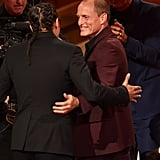 Cary being congratulated by True Detective stars Woody Harrelson and Matthew McConaughey.