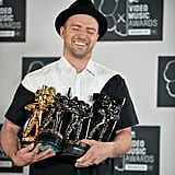 Justin Timberlake was all smiles while holding up his Moonmen in the press room.