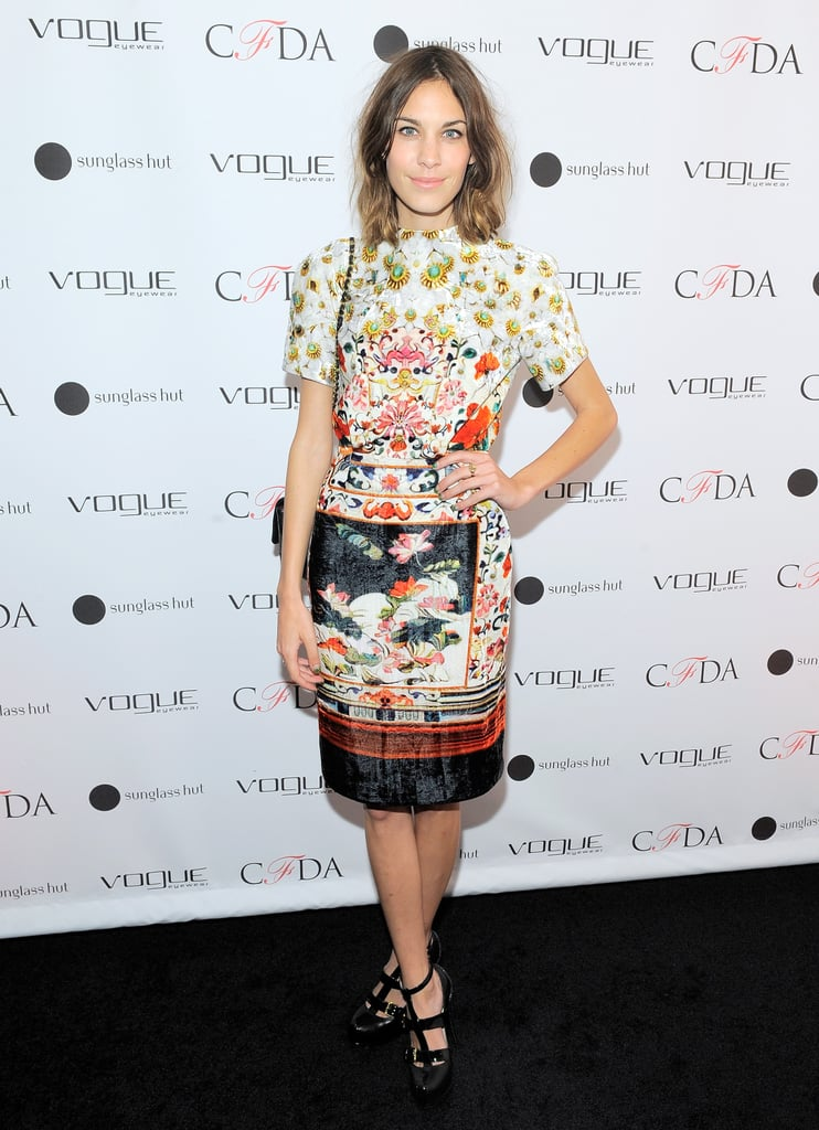 Alexa Chung wears a bright dress at a Vogue Eyewear launch in New York on Sept. 27.