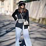 Give classic separates a forward twist by styling with a bucket hat, white shoes, and double bags.