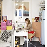 Small-space office solutions from Ikea, like the corner cabinet, keep this home office up and running.