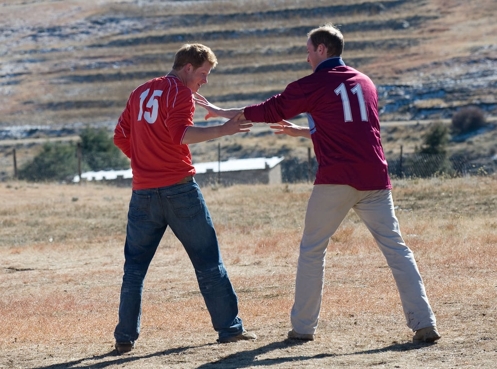 Things got competitive for the two as they played soccer with a group of kids during a visit to the Semongkong Children's Centre in Lesotho in June 2010.