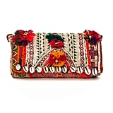 A black clutch won't do for the world traveler in your life. Instead, gift her this beautiful Bungalow 8 shell tribal clutch ($115) made by a local Mumbai artisan.
