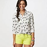 To go tropical in a hip, modern way, try this AE Palm Tree Shirt ($40) with a pair of bright shorts.