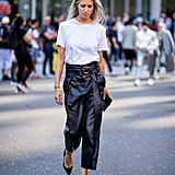What's cooler for evening than a white t-shirt tucked into leather trousers and heels?
