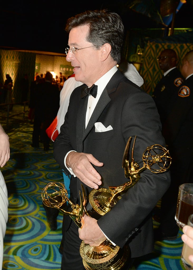 Stephen Colbert juggled his awards at the 2013 HBO Emmys after party.