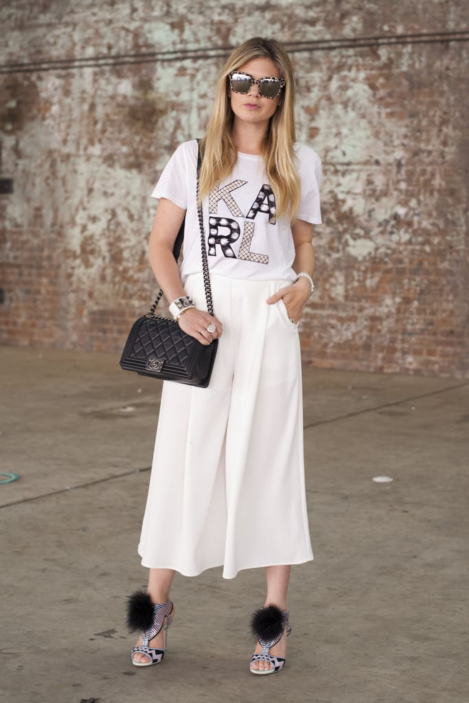 Make your favorite T-shirt work-appropriate by tucking it into a pair of culottes or a high-waisted skirt. Need to polish it off? Just add a blazer.