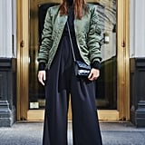 On Fashion Director Hannah Weil McKinley: Alpha Industries jacket, Misha Nonoo jumpsuit ($695), Chanel bag, and Westward Leaning sunglasses
