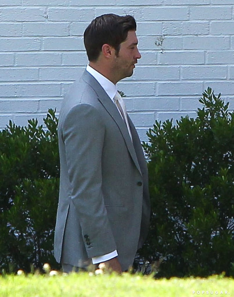 Jay Cutler wore a light gray suit.