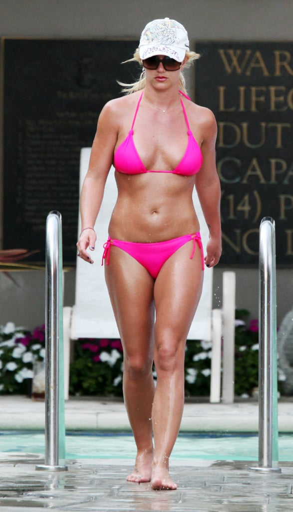 The singer emerged from the water in a pink two-piece while enjoying a pool day in LA in August 2009.