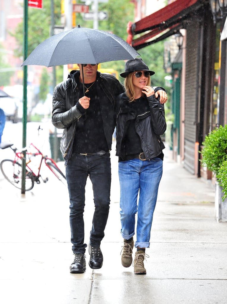 Jennifer Aniston and Justin Theroux could not have been more in sync with their outfits on a rainy day in 2011. The two wore black jackets and shirts with jeans, though Jen went with a lighter denim wash. They even coordinated in combat boots.