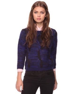 Top a classic button-up with this two-tone cable-knit sweater. Wool Blend Cable Knit Sweater ($21, originally $30)