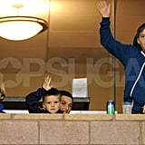 Romeo Beckham, Cruz Beckham, and Brooklyn Beckham waved to their dad from the stands.