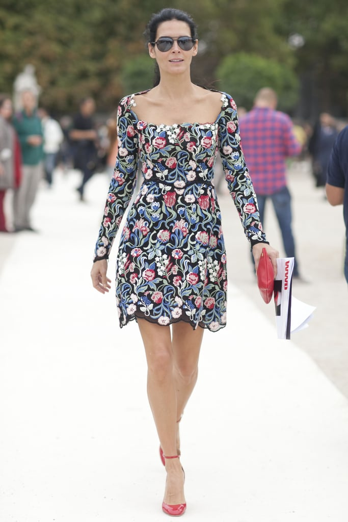 Angie Harmon stood out en route to the Paris shows in a floral minidress and red ankle-strap pumps.