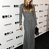 Devon Aoki chose a chic, long-sleeve, full-length gray dress.