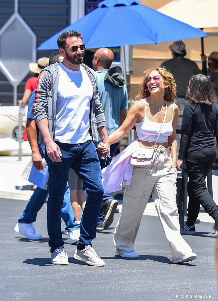"""Ben Affleck and Jennifer Lopez are giving their love another shot! The couple first got together in 2002 after meeting on the set of their movie Gigli, but after two years together — and an engagement — they called it quits due to the excessive media attention. Seventeen years later, however, it seems Jennifer and Ben just couldn't keep away from each other. In May, the two rekindled their romance, and since then, they've been practically inseparable, going out on date nights and taking trips together.  """"I'm super happy. I know people are always wondering, 'How are you? What's going on? Are you okay?' This is it. I've never been better,"""" Jennifer recently told Entertainment Tonight. """"I want my people who care about me, because I care about them so much, to know that I've really gotten to a place in my life where I'm great on my own. I think once you get to that place, then amazing things happen to you that you never imagine in your life happening again . . . that is where I'm at.""""  As Jennifer and Ben's rekindled romance continues to heat up, see all the cute moments they've shared since their reconciliation ahead.       Related:                                                                                                           12 Things J Lo and Ben Affleck Have Said About Each Other Since Their 2004 Breakup"""