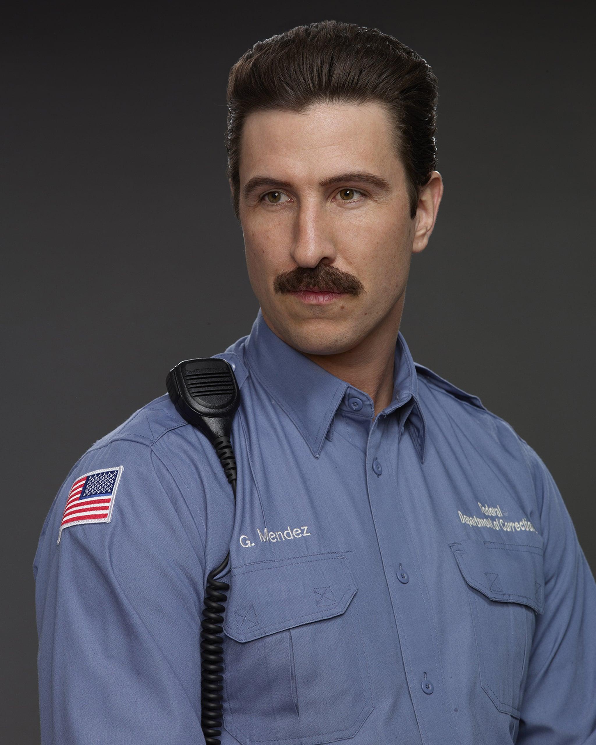 """Pablo Schreiber as George """"Pornstache"""" Mendez"""
